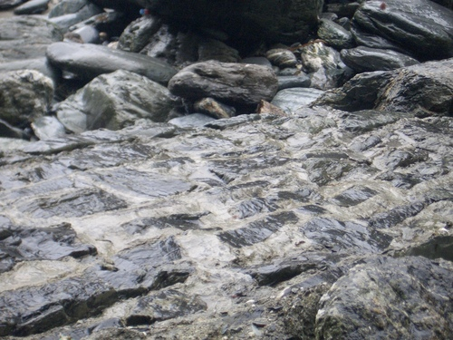 [Picture: Ruins of Tintagel Castle 13: Tide-washed bricks]