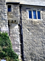 [picture: Castle wall with overhang]