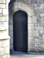 [picture: Oak doorway in stone wall]