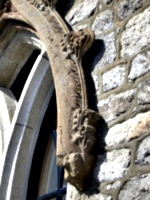 [picture: Floral stone-carving on an arch]
