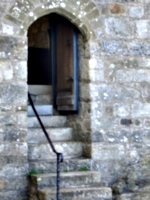 [picture: Stone steps leading up to a chapel door]
