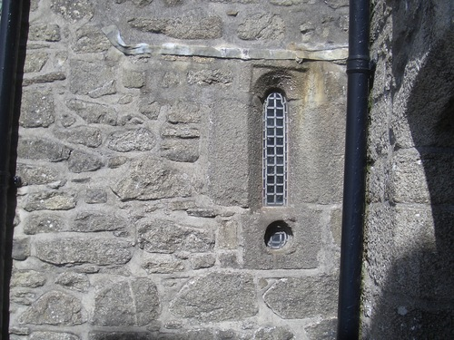 [Picture: Castle window with gun hole]