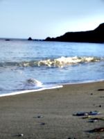 [picture: Wave on calm beach]