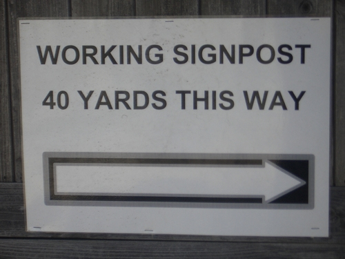 [Picture: Working Signpost 40 yards this way]