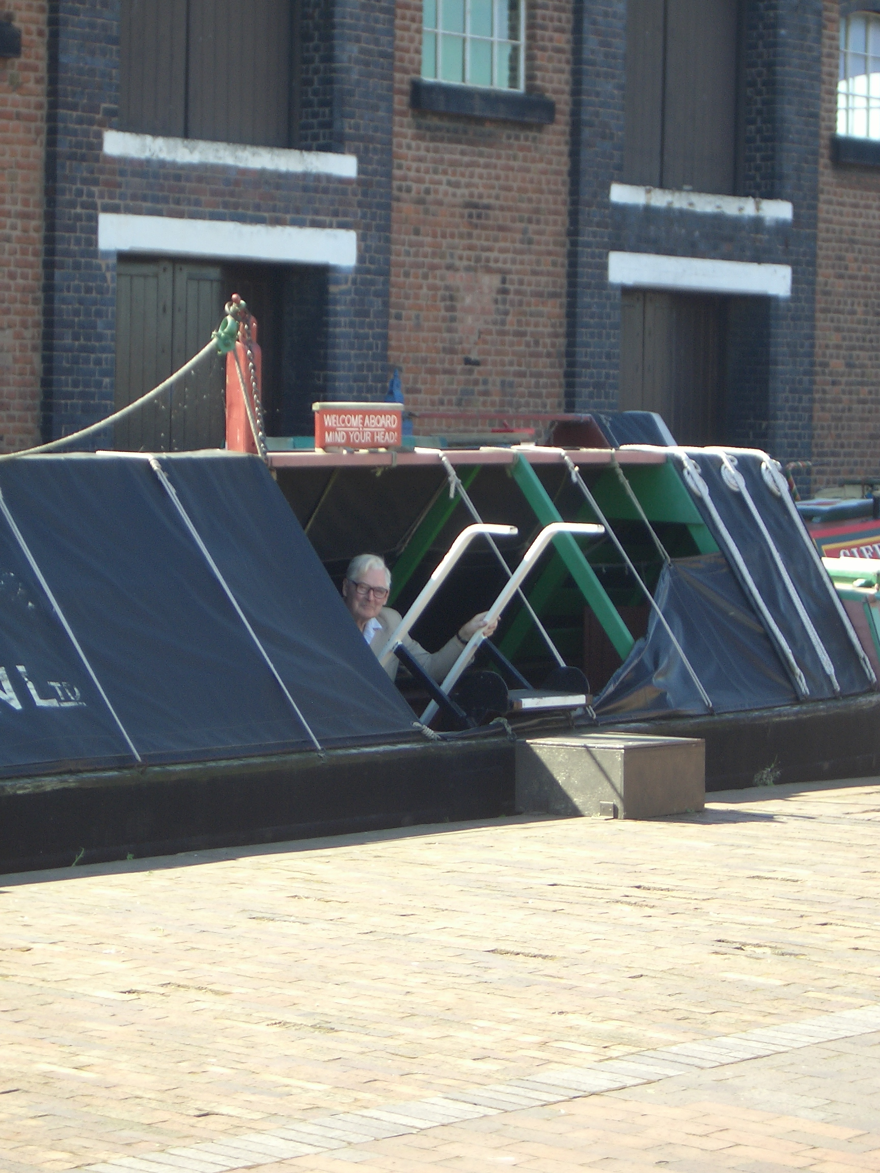 [Picture: Dad peeking out of a canal barge]