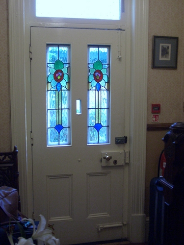 [Picture: Front door with stained glass leads]