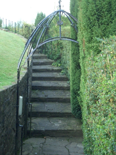 [Picture: Winding stone stairs in the garden]
