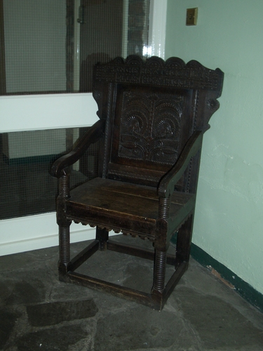 [Picture: ornate carved chair]
