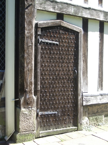 [Picture: Ancient studded oak door]