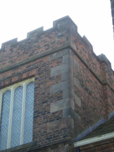 [Picture: Stone facing work on brick tower]