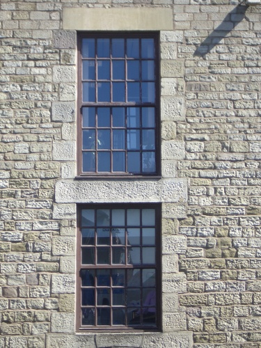 [Picture: Sash windows in stone wall]