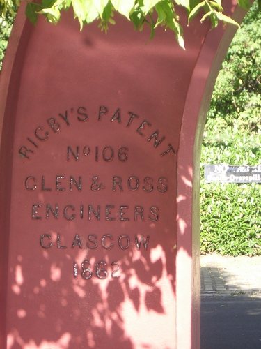[Picture: Red metal arch 2: closeup of writing]