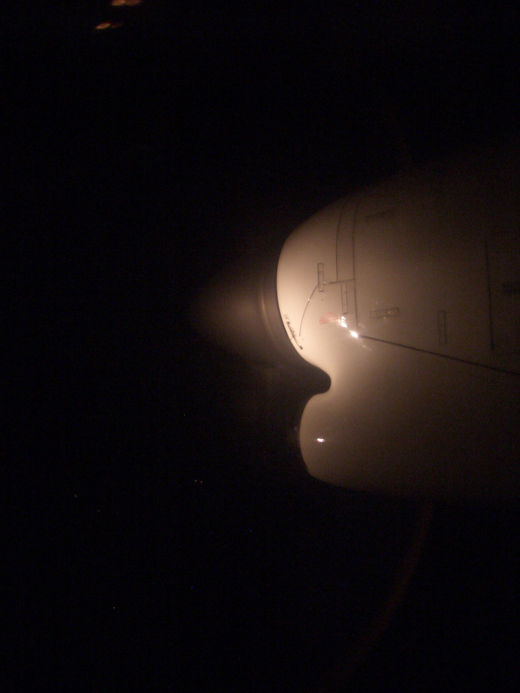 [Picture: Plane engine at night]