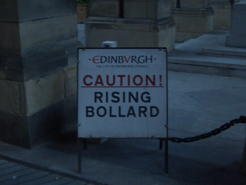 [Picture: Caution: Rising Bollard]