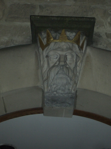 [Picture: Stone head with gold crown]