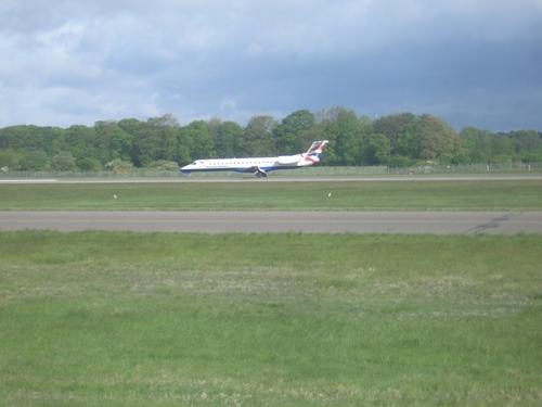 [Picture: Plane preparing to take off]