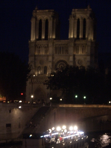 [Picture: Notre Dame at night]