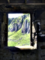 [picture: Cliff seen though old window]