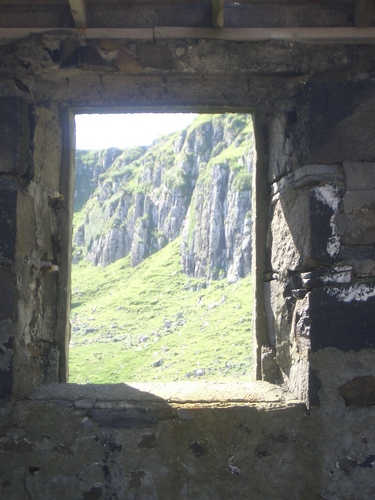 [Picture: Cliff seen through old window 2]