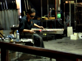 [picture: Shaping the glass]