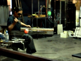 [picture: Shaping the new glass vase]