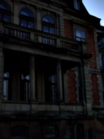 [picture: Creepy old building with stone balcony 2]