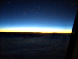 [picture: Sunset over the clouds]