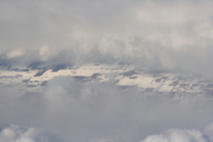 [picture: Snow-covered fields seen through clouds 2]