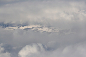 [picture: Snow-covered fields seen through clouds 4]