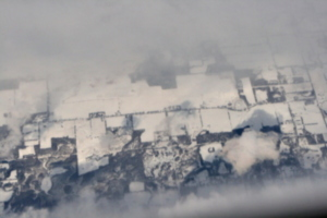[picture: Snow-covered fields seen through clouds 5]