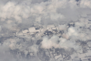 [picture: Snow-covered fields seen through clouds 6]