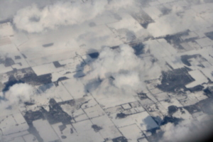 [picture: Snow-covered fields seen through clouds 7]