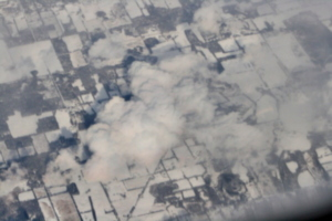 [picture: Snow-covered fields seen through clouds 8]
