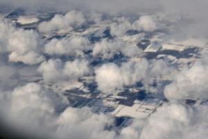 [picture: Snow-covered fields seen through clouds 10]