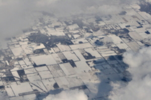 [picture: Snow-covered fields seen through clouds 11]