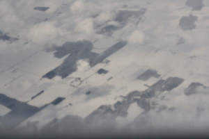 [picture: Snow-covered fields seen through clouds 15]