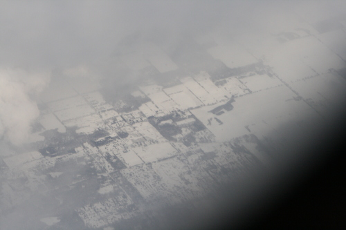 [Picture: Snow-covered fields seen through clouds 1]