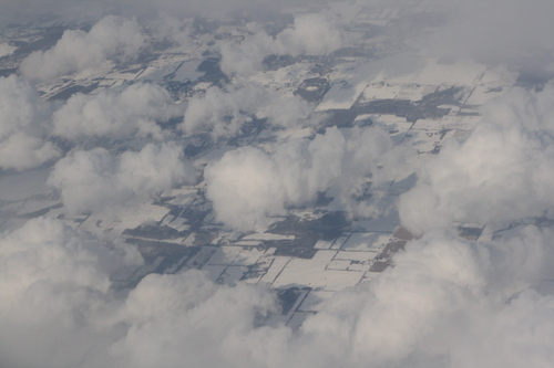 [Picture: Snow-covered fields seen through clouds 9]