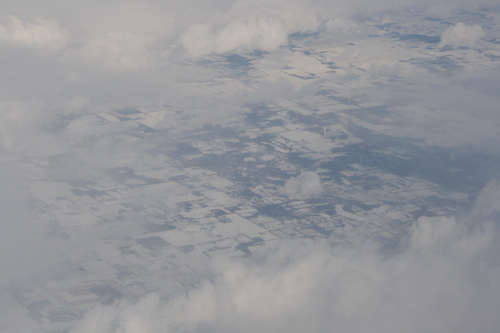[Picture: Snow-covered fields seen through clouds 12]