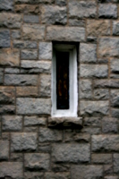 [picture: Stained-glass window in stone wall]