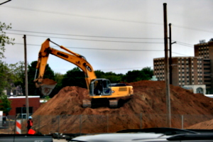 [picture: mechanical digger on a mound]