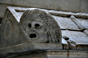[picture: Theatrical mask from late Roman stone coffin 2]