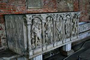 [picture: Richly carved sarcophagus]