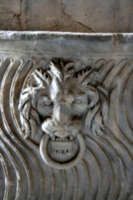 [picture: Stone lion's head with ring 2]