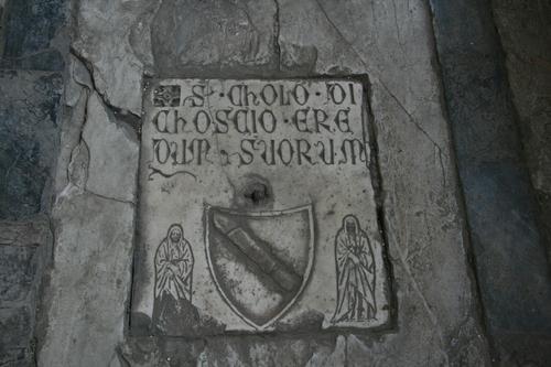 [Picture: Heraldic flagstone]