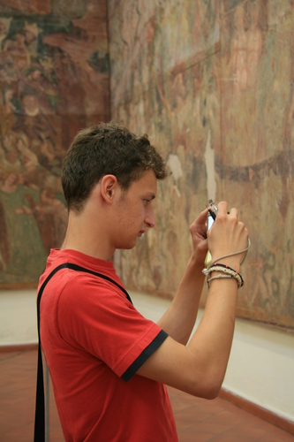 [Picture: Boy photographing fresco]