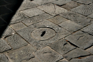 [picture: Stone man-hole cover]