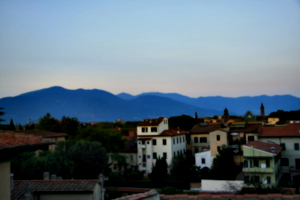 [picture: View from the Hotel Balcony 11: hills, trees, houses]