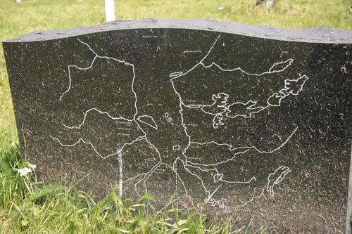 [Picture: Tombstone with a map]