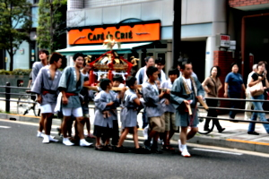 [picture: Children carrying the mikoshi]